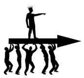 Silhouette  of a selfish man with a crown on his head indicates to people who carry him, where to move. The silhouette  of a selfish man with a crown on his head Stock Photos