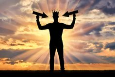 Silhouette of a selfish man with a crown on his head. Tries to attract attention by holding pointer in his hands. The concept of a selfish and narcissistic Stock Images
