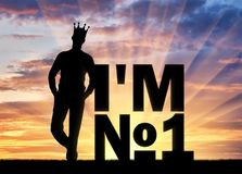 Silhouette of a selfish and narcissistic man with a crown on his head near the word, I`m number one. The concept of selfishness and narcissistic personality Royalty Free Stock Photography