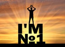 Silhouette of a selfish and narcissistic man, he wears a crown, standing on a word, I`m number one. The concept of selfishness and narcissistic personality Royalty Free Stock Photography