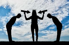 Silhouette of a selfish woman with a crown on her head trying to attract attention. The servants worship her. The concept of selfishness and narcissism Royalty Free Stock Photos