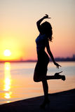 Silhouette of a sensual woman at sunrise perfect Stock Photography