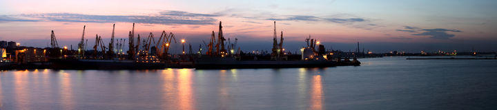 Silhouette of several cranes in a harbor Royalty Free Stock Photography