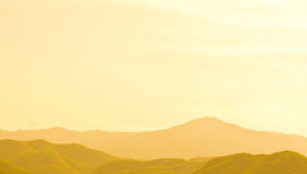 Silhouette of several mountains in the sunset Royalty Free Stock Images