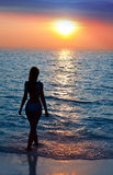 Silhouette of the sexual woman going at ocean Royalty Free Stock Photo