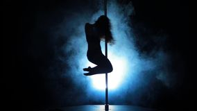 20of23 Silhouette of a sexy female pole dancing stock footage
