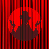 Silhouette, shadow, magician, actor, closed the curtain on a background of red, theater, circus, posters, arena,  isolated Stock Photo