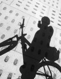 Cyclist tourist selfie shadow on paved path stock photos