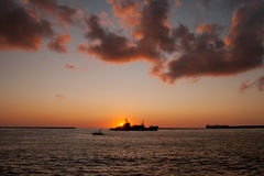 The  silhouette of a ship floating on the sea Royalty Free Stock Photo