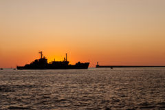 The  silhouette of a ship floating on the sea Stock Photography
