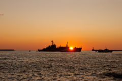 The  silhouette of a ship floating on the sea Royalty Free Stock Photography
