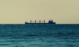 The silhouette of the ship on the sea Royalty Free Stock Photography