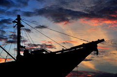 Silhouette of ship with sunset Stock Image