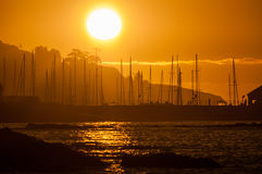 Silhouette of ships masts against sunset Royalty Free Stock Images
