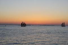 Silhouette of ships after sunset. On a boat tour in Keywest, Florida, this nic silhouettes of ships appeared just after the sunset Stock Images