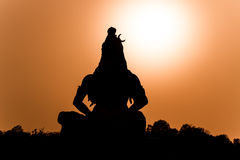 A silhouette of Shiva. A silhouette of a statue of the Hindu god Shiva on the banks of the Ganges at Rishikesh in North India Stock Photo