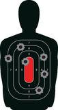 Silhouette Shooting Range Gun Target with Bullet H. Indoor shooting range silhouette paper target shot full of bullet holes Royalty Free Stock Image
