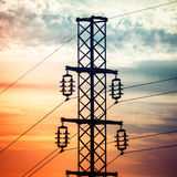 Silhouette shot of electricity pylons with cloudy sky Royalty Free Stock Image