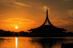 Silhouette shot of the iconic Ratchamongkol Pavillion at Rama 9. Public park . The shot is taken at sunrise Royalty Free Stock Images