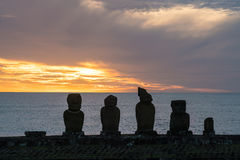 Silhouette shot of Moai statues in Easter Island Stock Image