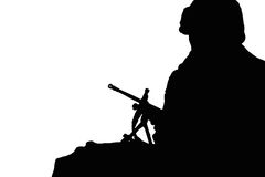 Silhouette shot of soldier and gun Stock Photos