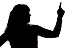 Silhouette of showing up woman, left side Stock Images