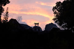 Silhouette of shrine and sunset, Kyoto Japan. Royalty Free Stock Image