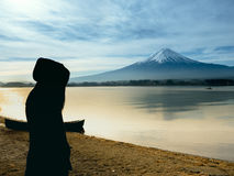 Silhouette side of asia girl traveler 30s to 40s stand and cover royalty free stock photography