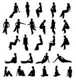 silhouette siedzącej kobiety Fotografia Stock