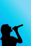 Silhouette singer. Woman over blue Stock Photos