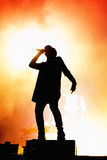 Silhouette of the singer of Chase & Status stock image