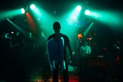 Silhouette of the singer at a live concert at the club at the event against the crowd. Of people in the audience stock photos