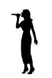 Silhouette singing woman Stock Image