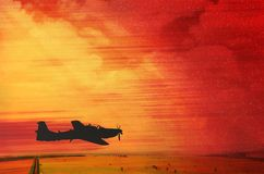 Silhouette of a single airplane flying on a fire red sky, seems. Like a post war flight. Dramatic look. Red clouds, warm colours. Space for text on the sky stock photos