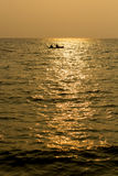 Silhouette single boat at sea in sunset Royalty Free Stock Photography