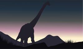 Silhouette of single brachiosaurus in hills Stock Image