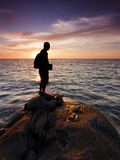 Silhouette of a single man at sunset Royalty Free Stock Photos