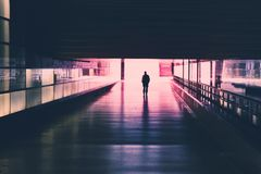 Silhouette of a single person walking in tunnel. Silhouette of a single person walking in a dark   tunnel Stock Images