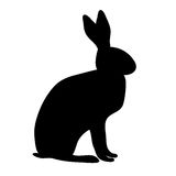 Silhouette sitting rabbit or hare with ears, paws and tail stock illustration