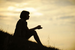 Silhouette of Sitting Woman Stock Images