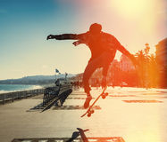 Silhouette of skateboarder Stock Photo