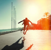 Silhouette of skateboarder Stock Photography