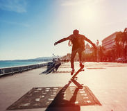 Silhouette of skateboarder Stock Images