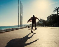 Silhouette of skateboarder Stock Photos