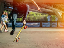 Silhouette skateboarder jumping in city Stock Photography