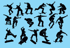 Silhouette of skateboarder. Skateboard on a blue background. Silhouette of extreme sports Stock Photography