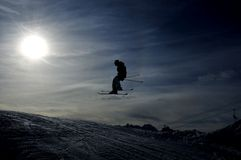 Silhouette of skier jumping Royalty Free Stock Images