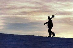 Silhouette of a skier at sunset Royalty Free Stock Images