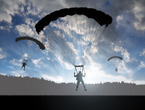 Silhouette skydiver parachutist landing Stock Photography