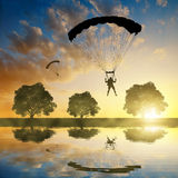 Silhouette skydiver parachutist landing Royalty Free Stock Image